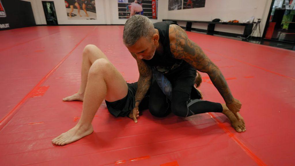 instructor-braga-shows-triangle